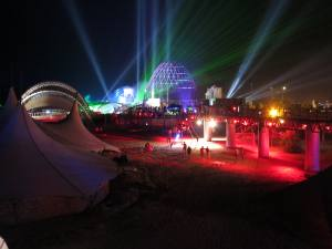 KaZantip Z21 at night with colorful lights and many sky beams