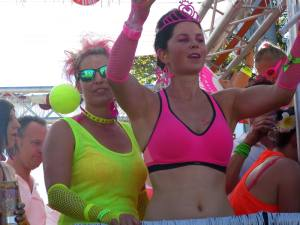 Nice girls with neon clothes on the famous Street Parade 2015 in Zurich, Switzerland